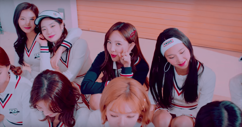 "WATCH: TWICE Drops Fun New MV For ""BRAND NEW GIRL"""