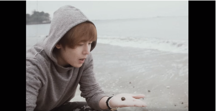 "WATCH: 2PM's Nichkhun Enjoys The Beach In New ""Umbrella"" MV"