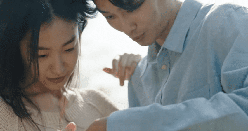 "WATCH: Huh Gak And Jung Eunji Bring Feelings Of Dread And Separation In ""Let You Go"" MV"